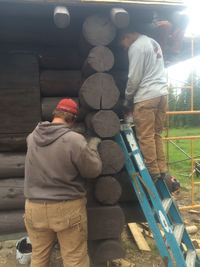 Joe and Logan priming the new log ends.